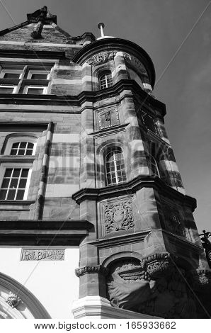An exterior view of the detail of the architecture on a corner building in Burntisland
