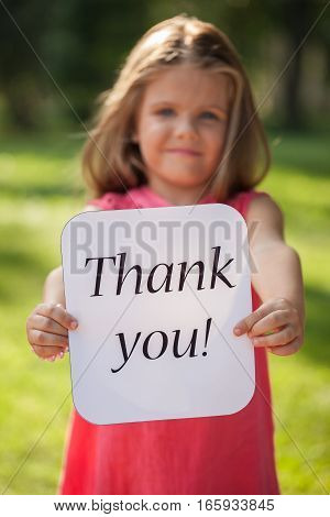 Portrait of a Little Girl Holding a Thank You Sign