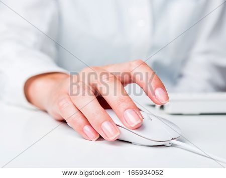 Closeup of an Employee Typing on a Keyboard and Holding Mouse