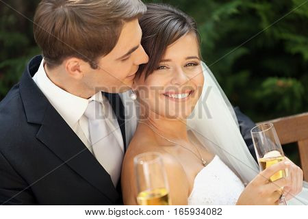 Portrait of a Smiling Wedding Couple Holding Champagne Glasses
