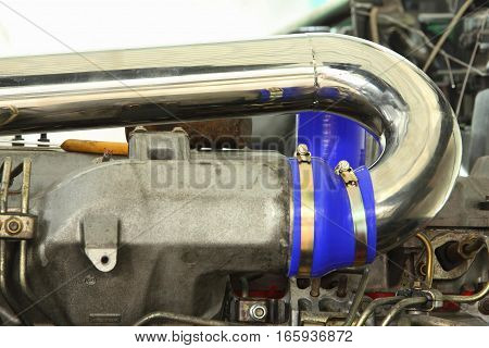 Close-up exhaust pipe of turbocharger in engine