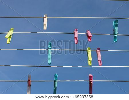 blue sky wires and pegs clothespins on the background