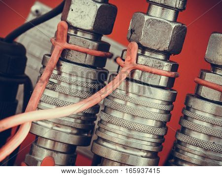 Industrial electric auto motor concept. Detailed closeup of spark plugs in machine engine
