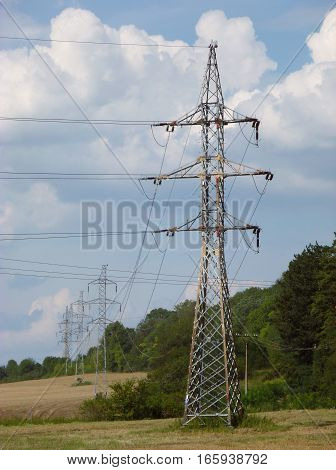Photo of high voltage pylons standing in a line