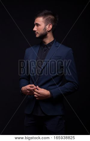 Man Posing Studio Elegant Suit, Looking Sideways