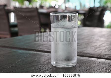 Glass of cold water on table .