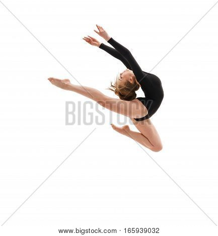 Young blonde girl in black sportsuit in graceful jump studio shot