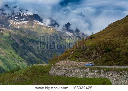 Beautiful Austrian mountains Alps and car on road