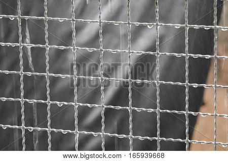 raindrop on steel net with copy space