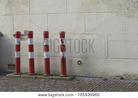 A row of bike poles in red and white