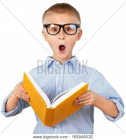 Brainy young boy surprised while reading a book