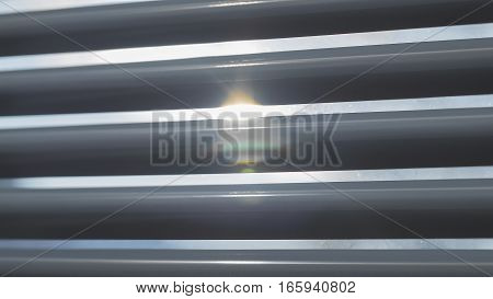 The sun is shining through the blinds