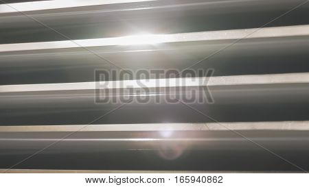 The sun lights shining through the blinds