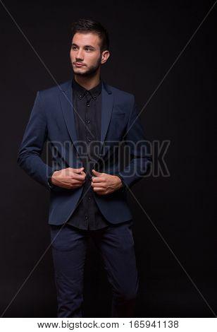 Young Adult Man, Looking Sideways, Black Dark Suit Elegant