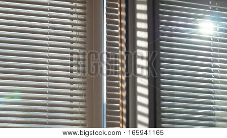 The sun is shining and glowing through the blinds