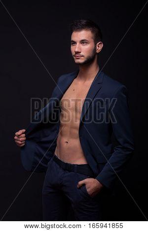 Young Man Looking Sideways, Posing Shirtless Suit Jacket Pants