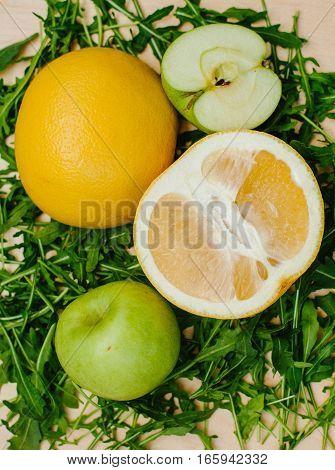 Citrus fruit on Arugula. Food organic sweet