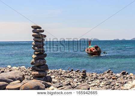 Smooth Stones Stacked On Each Other On The Beach. Tower Of Stones For Meditation On A Sea