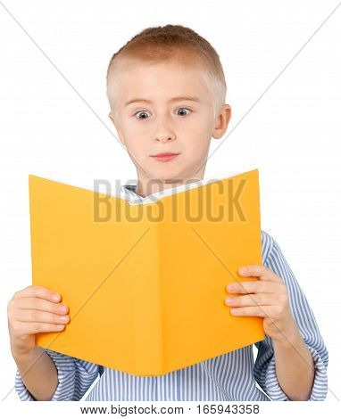 Young boy reading a book eyes bugging out