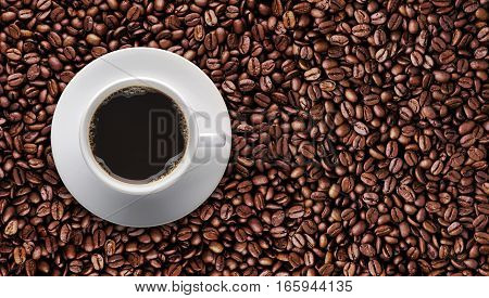 Coffee cup on roast coffee bean with copy space for text sign symbol or graphic design. Top view - Bird eyes view of hot coffee cup on raw coffee beans.