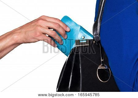Pick pocket taking a wallet from a purse