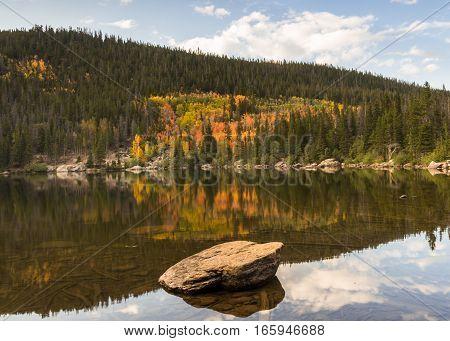 Autumn color reflection at Bear Lake, in Rocky Mountain National Park, near Estes Park, Colorado.