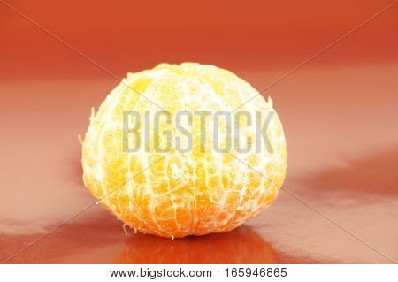 Ripe orange tangerines isolated on a red background