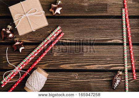 New Year decorations on the brown rustic wooden table. Christmas preparation concept. Copy space