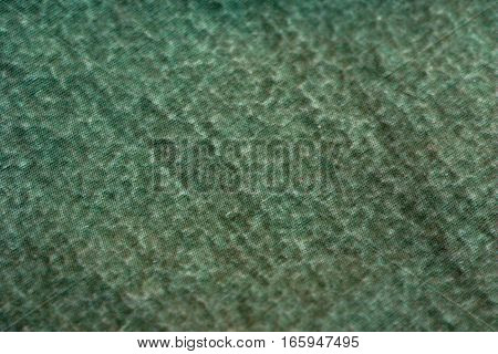 abstract texture of green wet material damaged membrane of hiking jacket