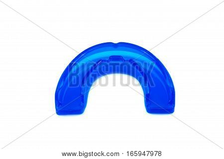 Blue mouthguard isolated on a white background.