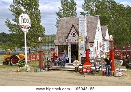 ROLLAG, MINNESOTA, Sept 1. 2016: The Tydol filling station with brand name signs, oil cans , and advertising signs are displayed at the West Central Steam Threshers Reunion in Rollag, MN attended by 1000's held annually on Labor Day weekend.