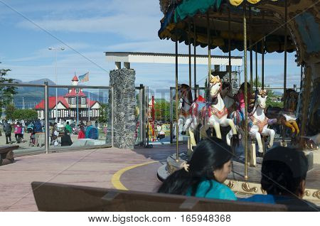 USUAIA ARGENTINA 05 DICEMBER 2016: day off in Ushuaia numerous people relaxing next to amusement park