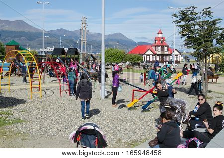 USHUAIA ARGENTINA 05 DECEMBER 2016: day off in Ushuaia parents with little kids at the playground