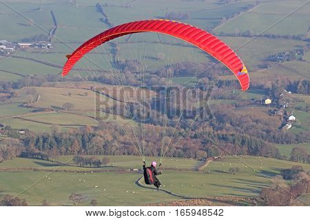 Paraglider flying in the Brecon Beacons, Wales
