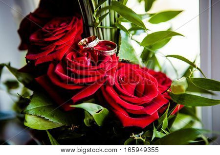 Still life with wedding rings and flowers