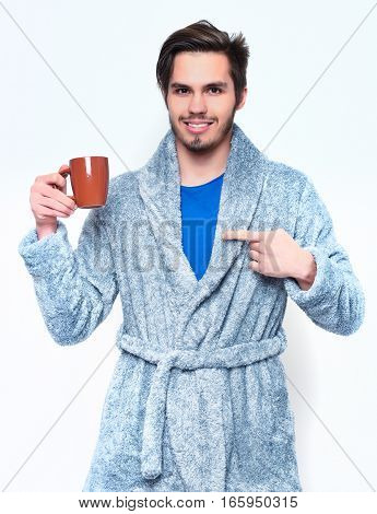 Handsome Bearded Smiling Man With Cup In Terry Bathrobe