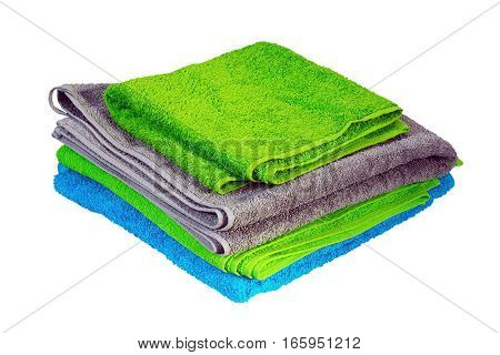 stack of colorful towels isolated over white background ( green blue gray )
