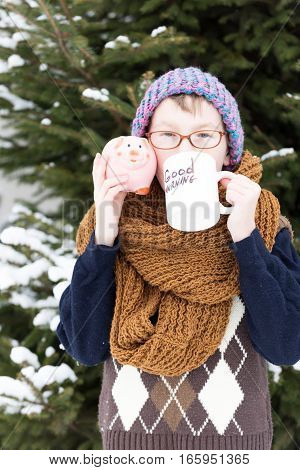 Small Boy With Cup And Moneybox In Winter Outdoor