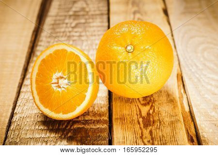 delicious and juicy oranges on a wooden table