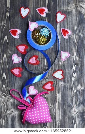 Felt Heart And Ribbon Bow On Wood As Valentines Decoration