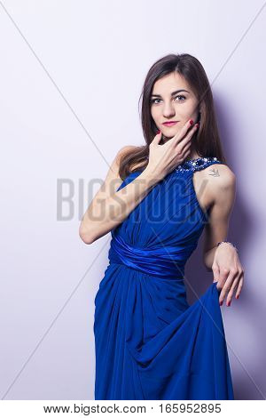 Portrait of a beautiful girl in a blue dress