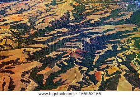 Aerial view over agricultural fields and hills in Greece