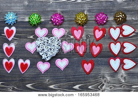 Bows And Felt Heart Love On Wood As Valentines Decoration