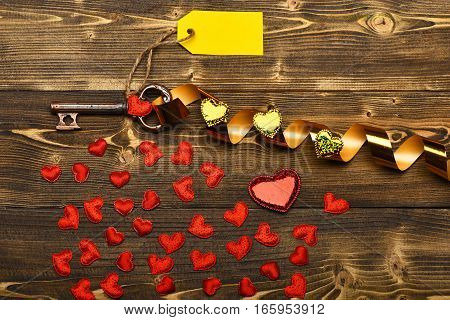 Valentines Red Heart, Tag, Gold Ribbon And Key On Wood