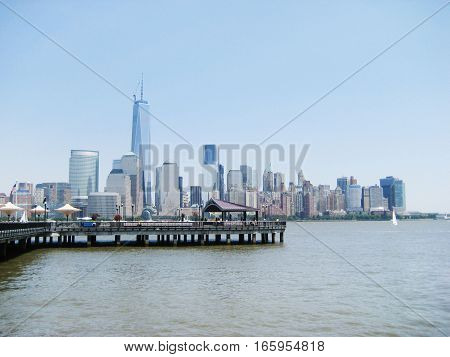 Downtown Manhattan skyscrapers in New York City, USA view from New Jersey state with the pier. Famous wallpaper on sunny summer july day in NY