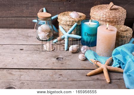 Coastal theme decorations on aged wooden background. Sea objects on wooden planks. Selective focus. Place for text.