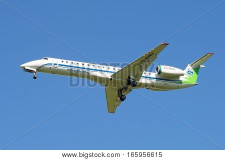 ST. PETERSBURG, RUSSIA - AUGUST 24, 2016: The Embraer ERJ-145LR plane (onboard VQ-BWU) Airline Komiaviatrans in the blue sky
