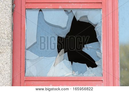 image of broken glass in the window