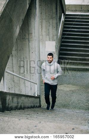 Man Running On Urban Stairs