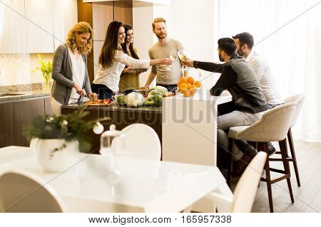 Friends Toasting With White Wine Joyous Event